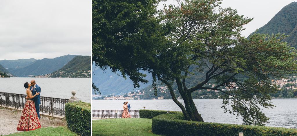 I due sposi si baciano con dietro la splendida cornice del lago di Como