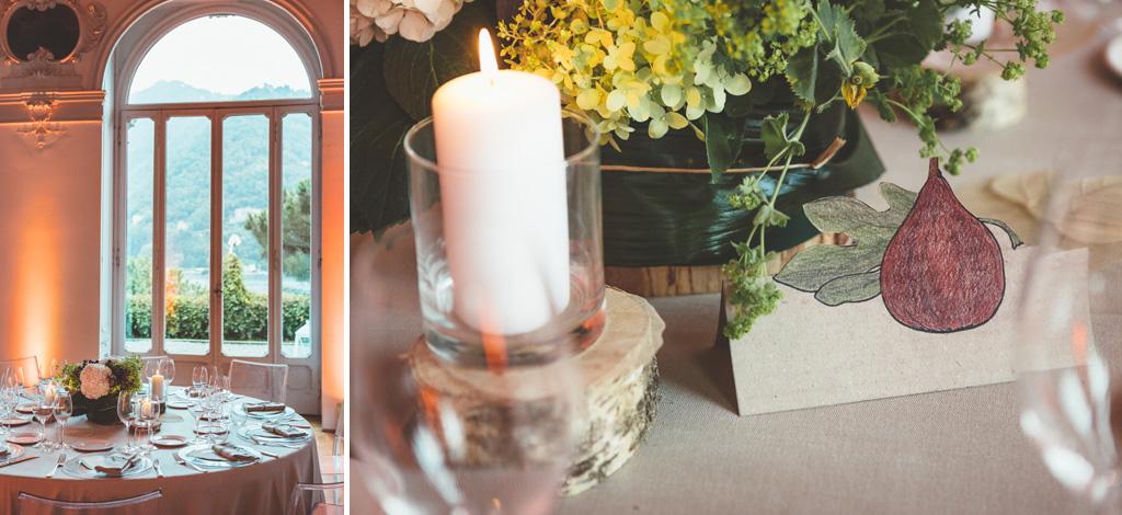 Il dettaglio di una candela sulla tavola del ricevimento