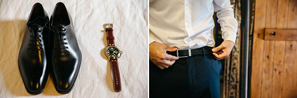 Still life di scarpe e orologio dello sposo mentre si mette la cintura