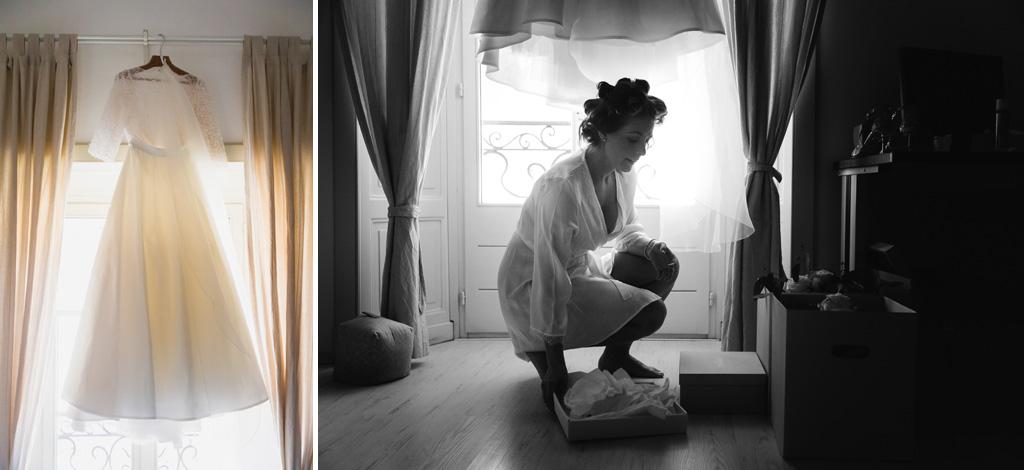 L'abito della sposa alla luce della finestra e la sposa apre la scatola delle scarpe