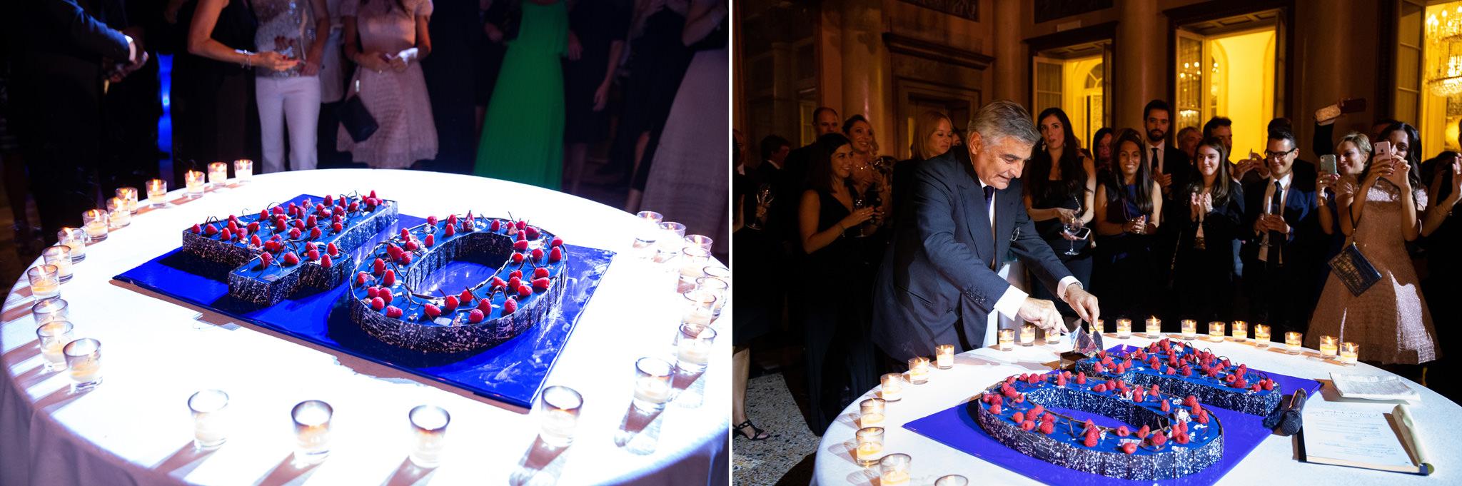 L'avvocato Enrico Raffaelli taglia la torta del quarantesimo anniversario dello studio legale